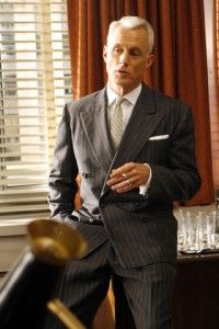 d74452710a Roger Sterling from Mad Men s suiting style. Double breasted pin stripe  with pocket square white shirt and tie.