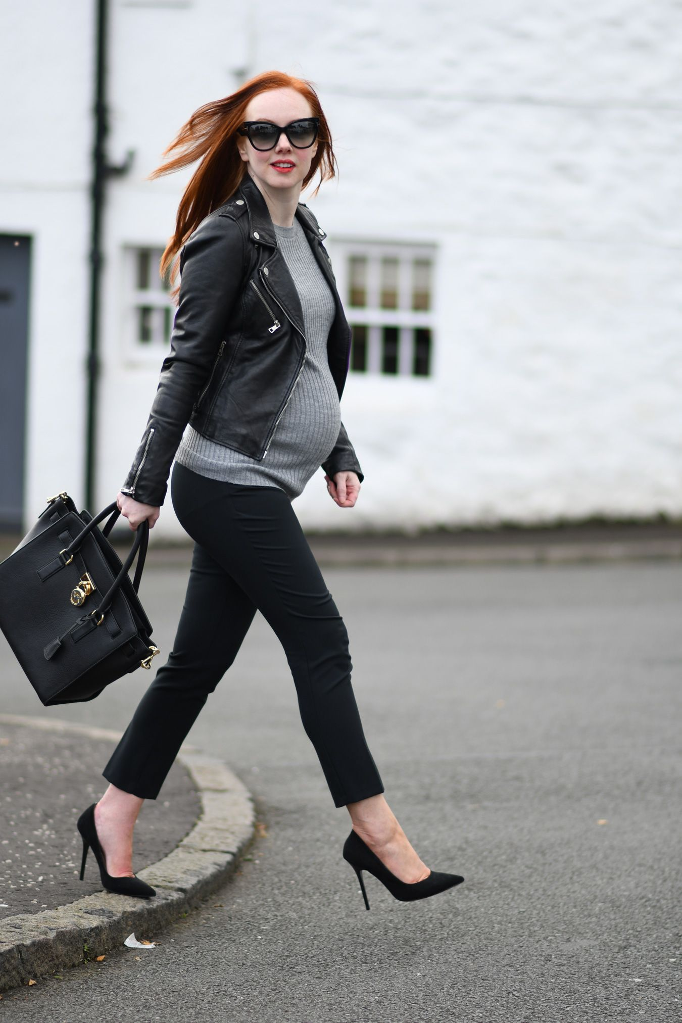 af737d8c3e5cb maternity style: black cropped trousers with leather biker jacket and high  heels