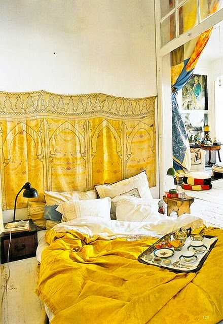 I'm not quite this bohemian, but this is beautiful and looks like the kind of bed that will have a very sexy, scruffy, starving artist sleeping in it with you ;-)