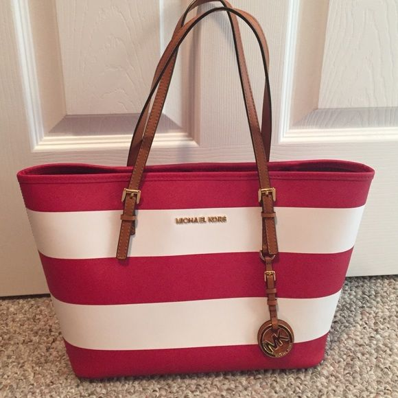 """Michael Kors Handbag This is a red & white striped tote. """"Michael Kors Jet Set Travel Stripe"""". I purchased this bag at Nordstrom & I have the tag. It is in great condition - like new! Michael Kors Bags Totes"""