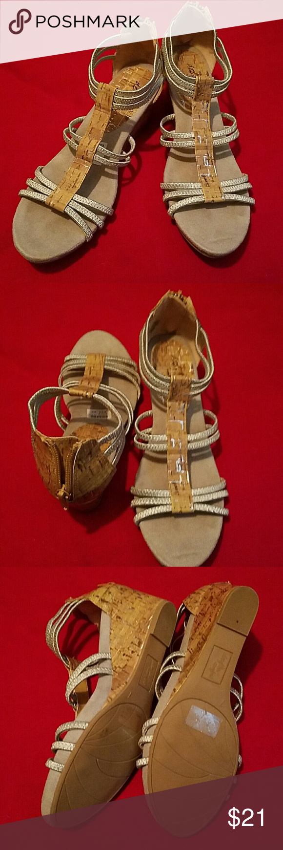 Cute wedge heels size 7 These Shoes are silver and cork wedges size 7. They were worn once and are in like-new condition and still have the tags on them. The wedge is approximately 2 inches and they zip up the back. Deflect Comfort   Shoes