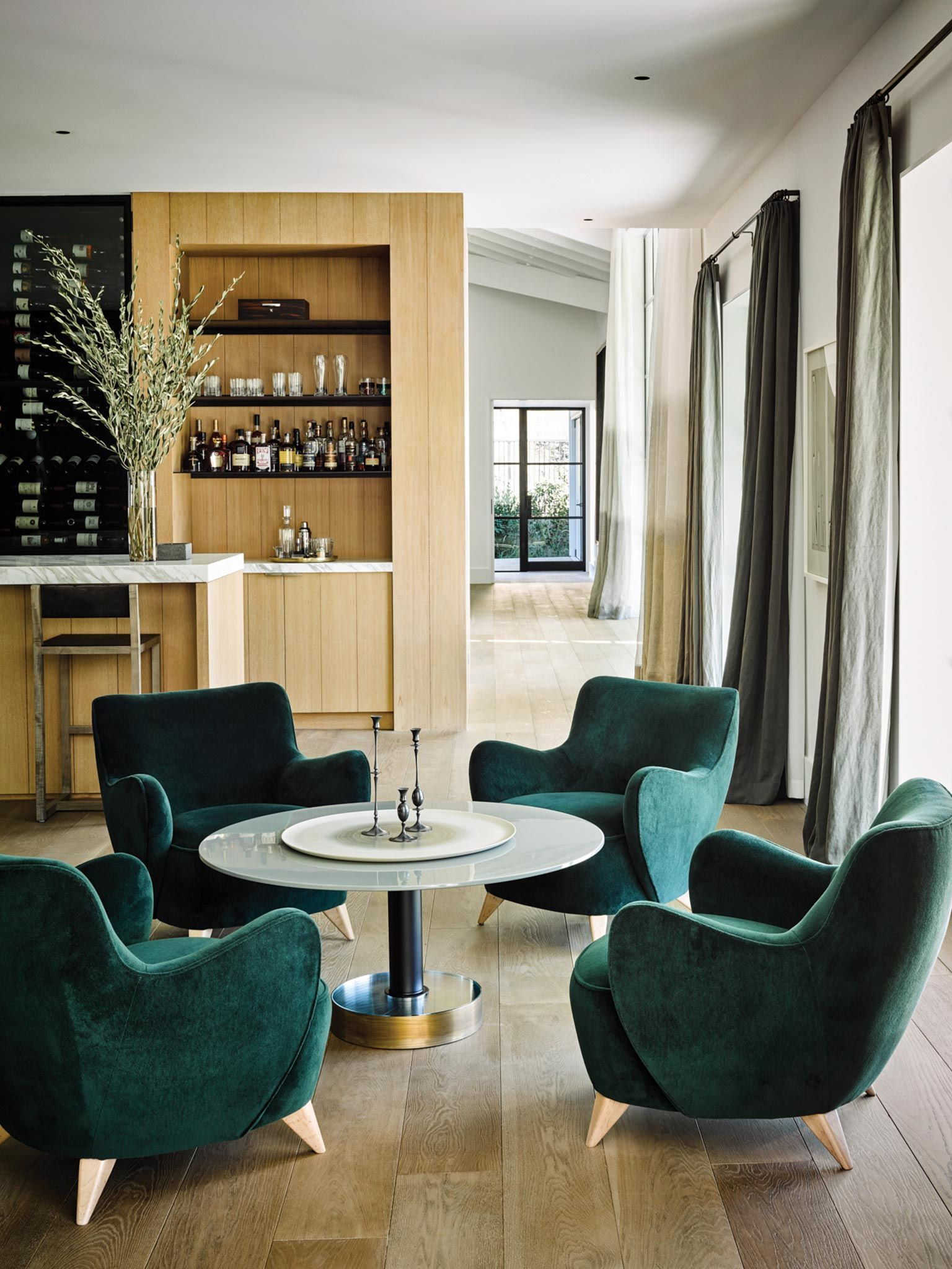 Dark Emerald Velvet Chairs Home Bar Vertical Wood Paneling Mid Century Modern Home Nicole Hollis Home Mid Century Modern House Home Decor