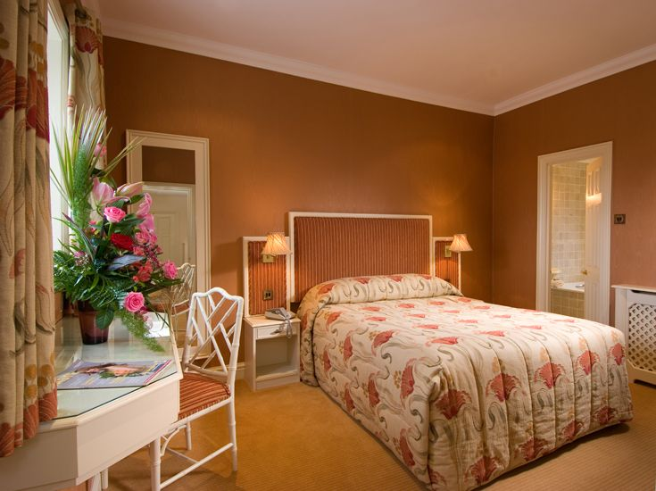 the use of caramel colours on the walls makes the room at inglewood manor hotel