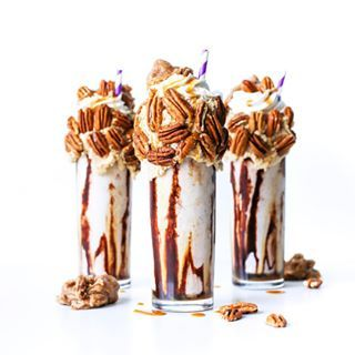 Mardi Gras may have ended but you can still makes these yummy Bourbon Praline Milkshakes made with praline ice cream homemade caramel frosting and topped with homemade pralines and pecans saltymilkshakes