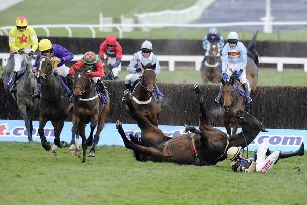 Davy Russell riding Lord Windermere (second left) wins The RSA Steeple Chase as Boston Bob and Paul Townend fall during Ladies Day at Cheltenham racecourse on March 13 in Cheltenham, England