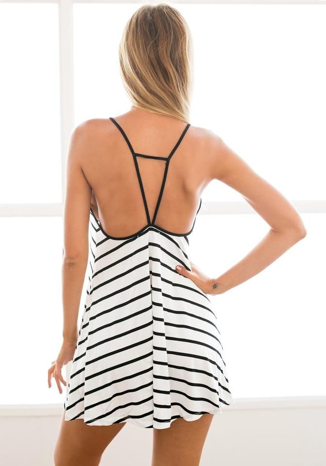 Back view of model in black and white stripe dress