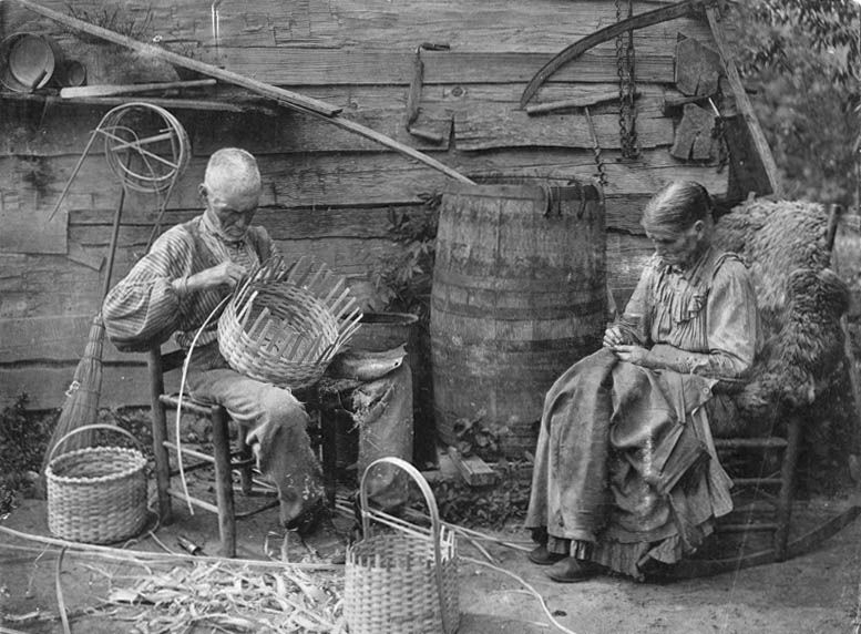 old man basket weaving and old lady sewing