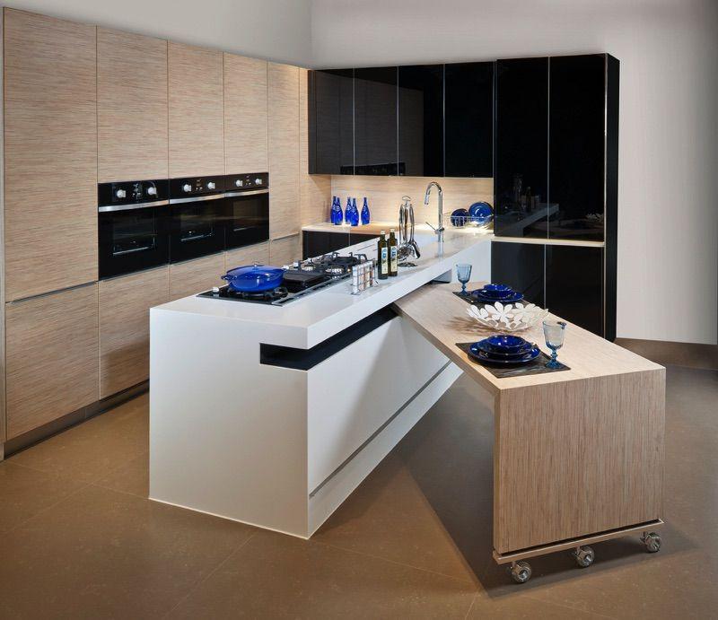 petite table sur roulette cach e dans l 39 ilot de cuisine pour plus de praticit projets. Black Bedroom Furniture Sets. Home Design Ideas