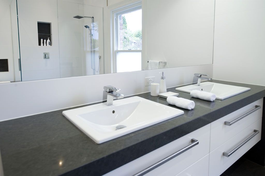 White Vanity With Dark Bench Caesarstone Raven