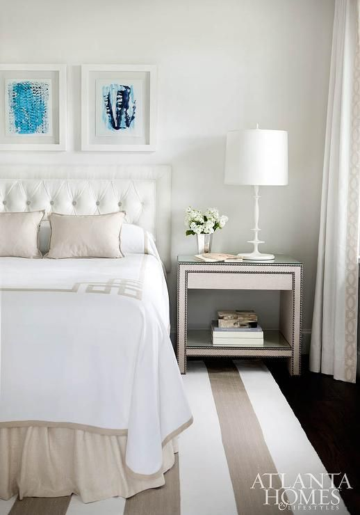 White and beige bedroom features turquoise art in see through ...