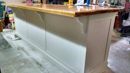 White Kitchen Island With Epoxy 2x6 Countertop With Seating Space