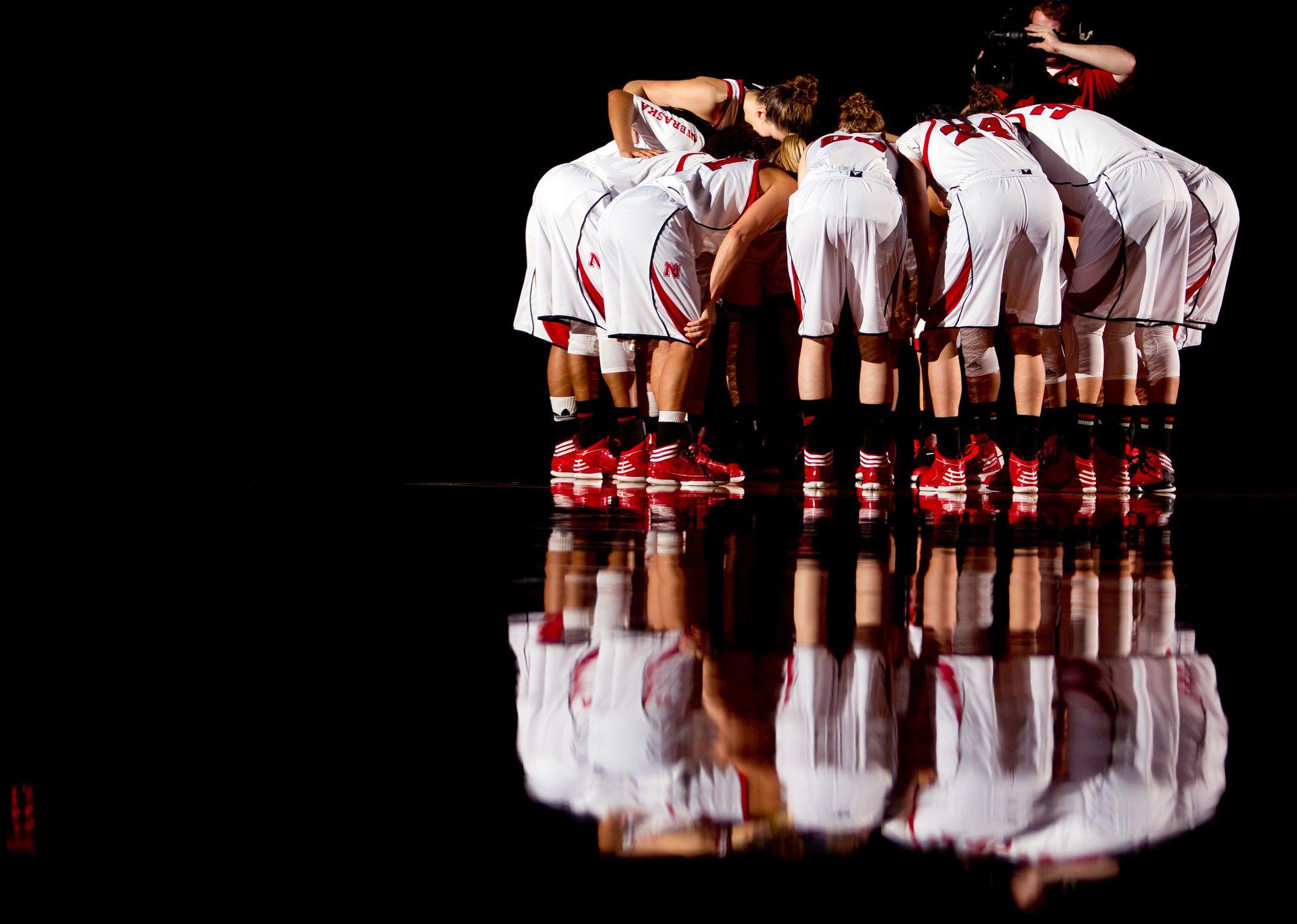 The Nebraska women's basketball team meets in a huddle