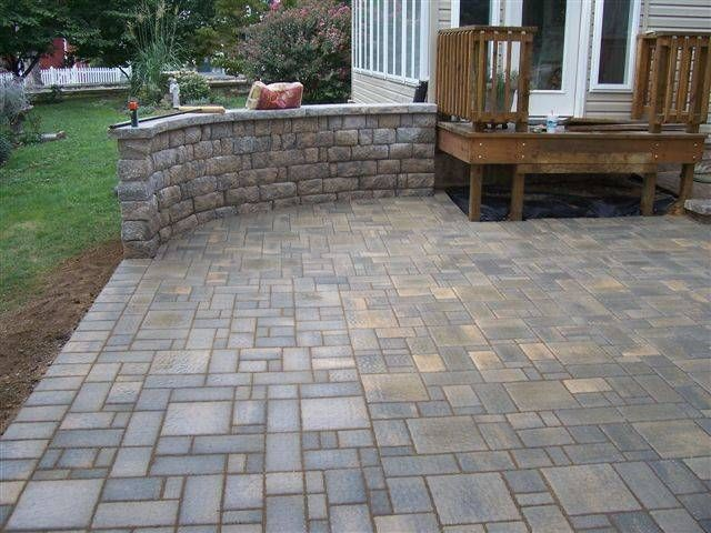 poured concrete patio and retaining wall Backyard