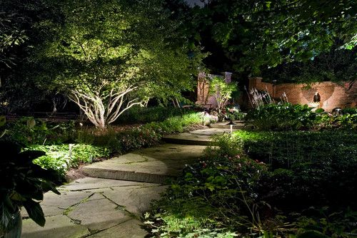 Low voltage path lights and up lighting extend the garden's usefulness into the evening hours and highlights steps within the garden path.
