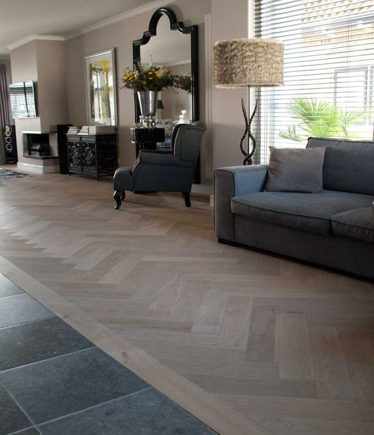 Transition between tiles and wooden floor and herringbone parquet with .. .