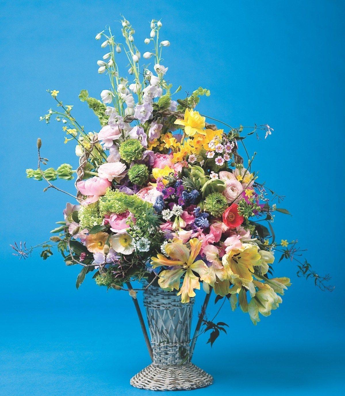 A Tisket A Tasket Flowers In A Basket Basket Flower Arrangements Flowers Magnolia Branch