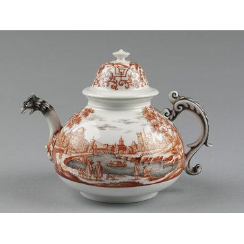 Teapot and cover This teapot was made by the Meissen factory but decorated in the distinctive style of Ignaz Preissler, probably the best known of all the independent enamellers of Meissen porcelain.  The teapot's early shape would suggest it was made in 1720-25 . Preissler would have bought it as a plain white piece and decorated it in his own workshop during the decade 1720-30. He used a combination of black (Schwarzlot) and red (Eisenrot) enamels to depict what is thought to be a view of…