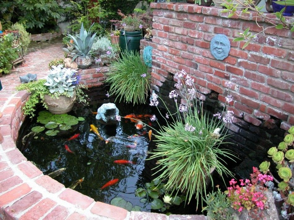 adding finishing touches to a new pond