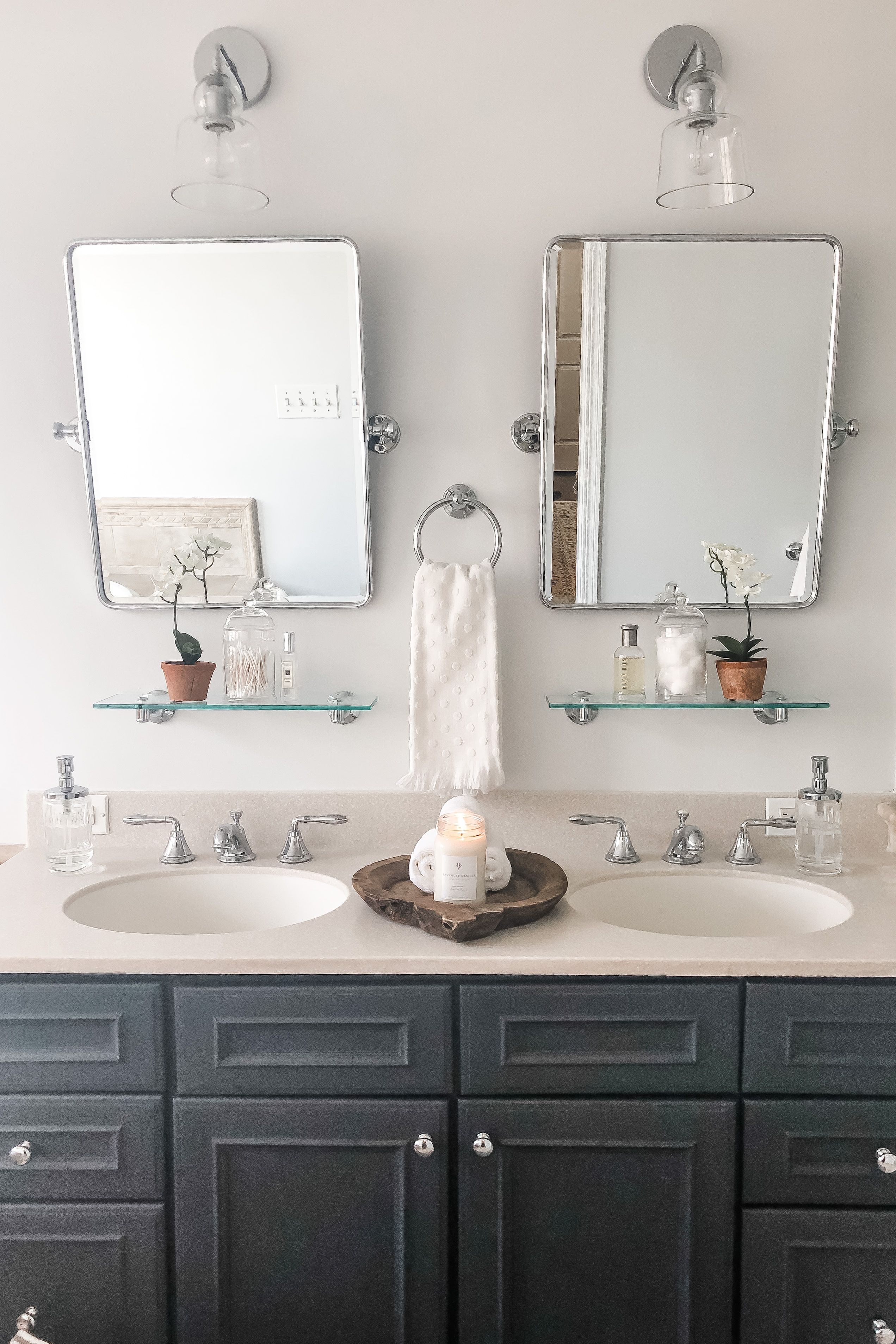 Photo of Gorgeous Renovated Bathroom with Wall Sconces