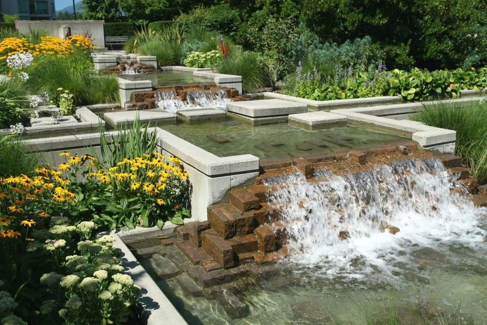 Mini Waterfall With Many Flowers And Plants Around Garden Design ...