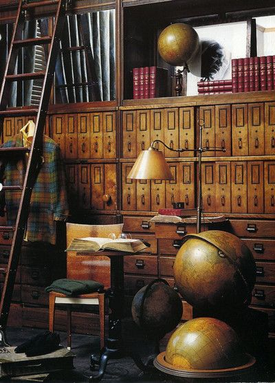 Those cabinets are divine--and the globes and lamp and ladder and everything else.!