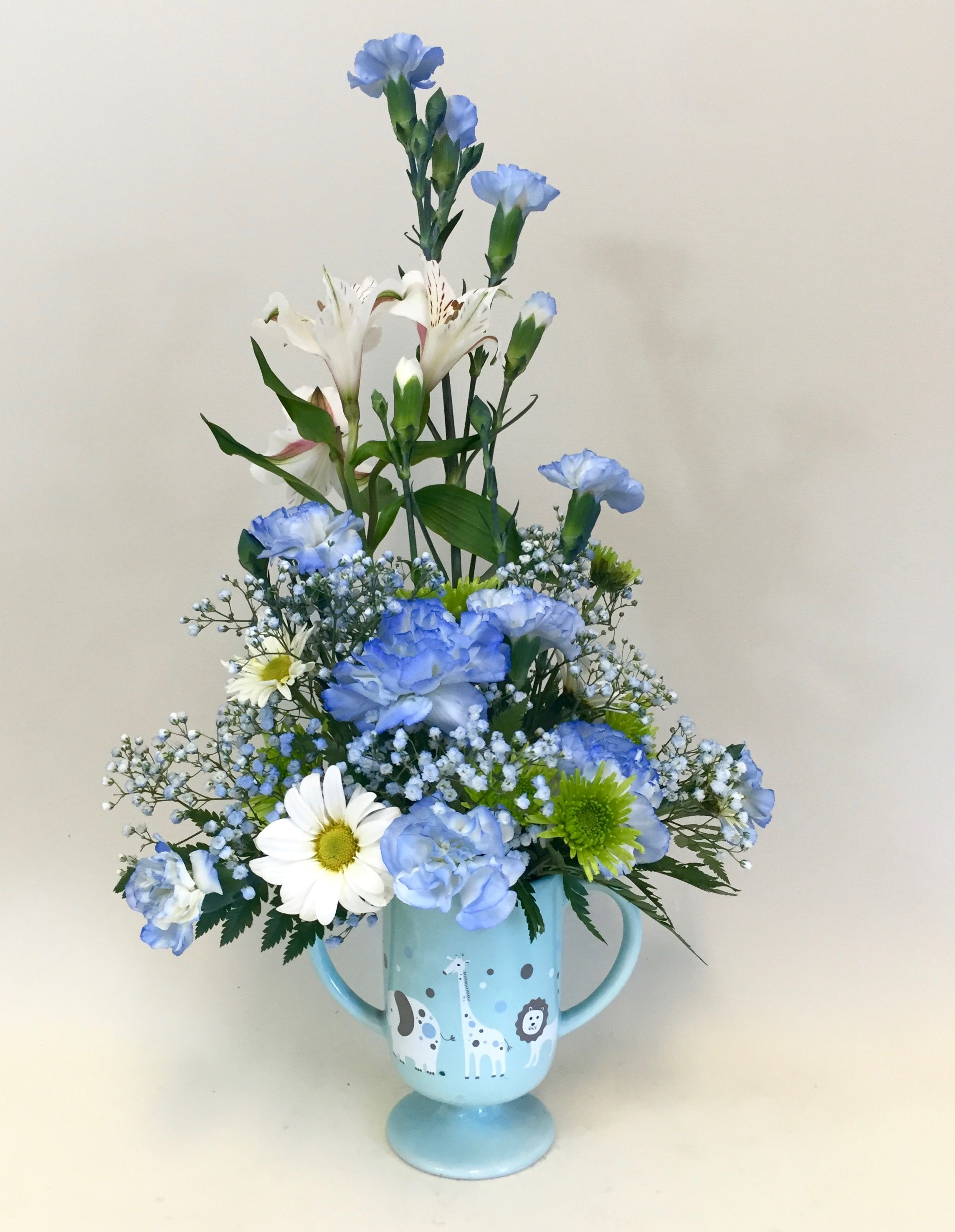 Baby Boy Arrangement In Mug Featuring Carnations Daisies Poms And