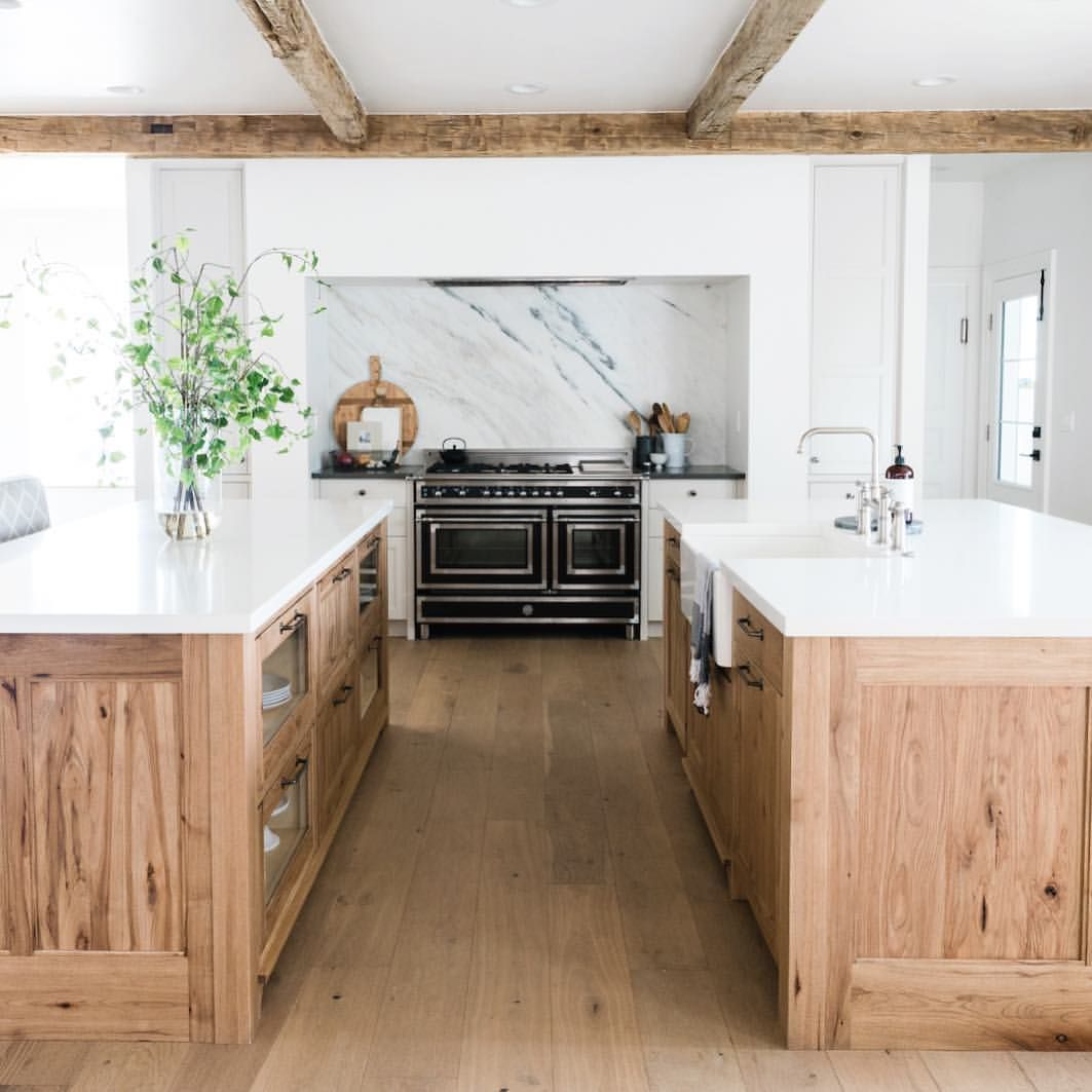 The Warm Wood Cabinets And Beams Paired With The Black Stove And And Marble Backsplash Is The Winning Com Kitchen Marble Wood Kitchen Cabinets Kitchen Design