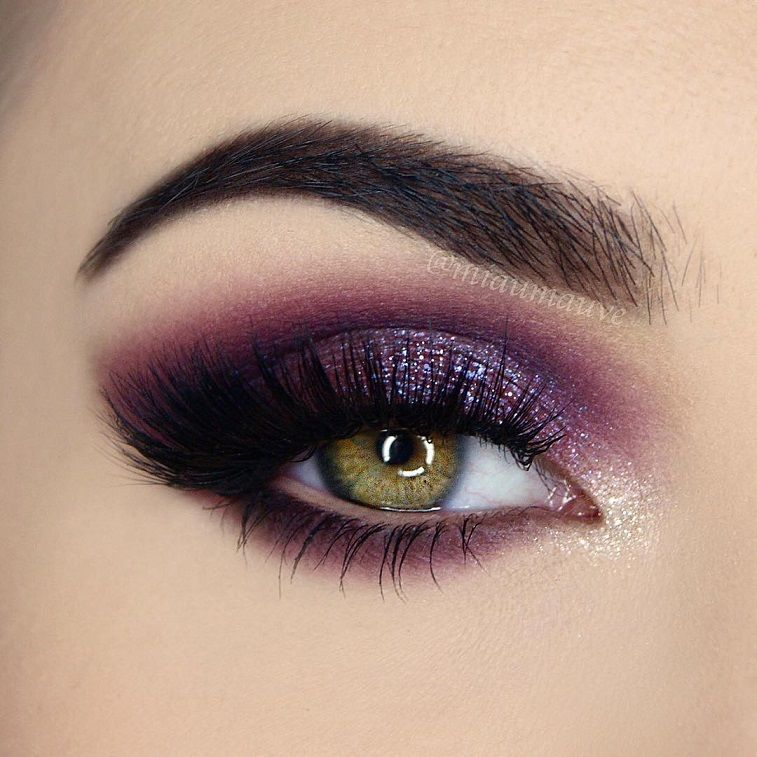 Gorgeous eye makeup in purple glitter