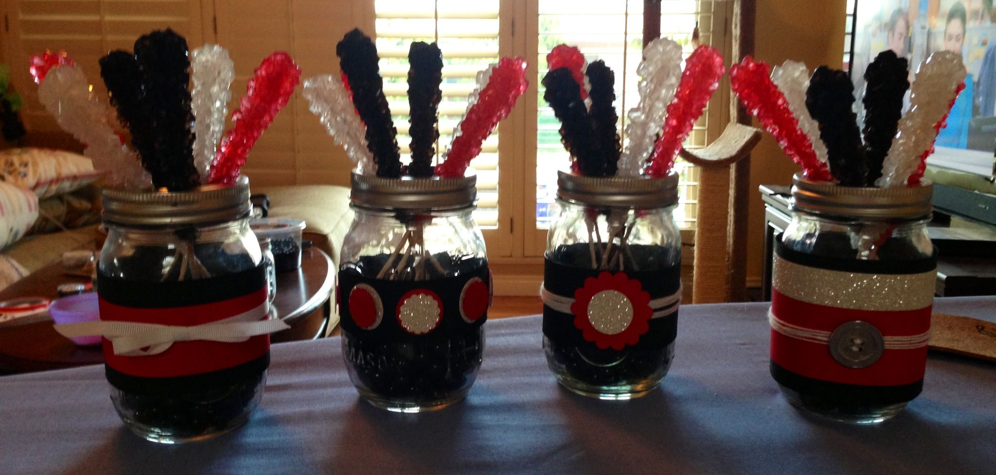 Red and black table decorations mason jars rock candy