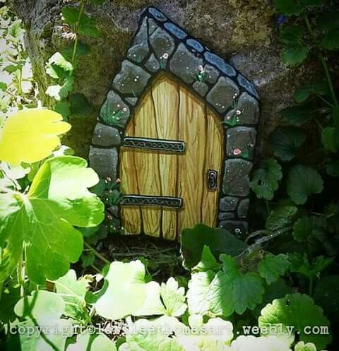 Fairy door, painted rock.