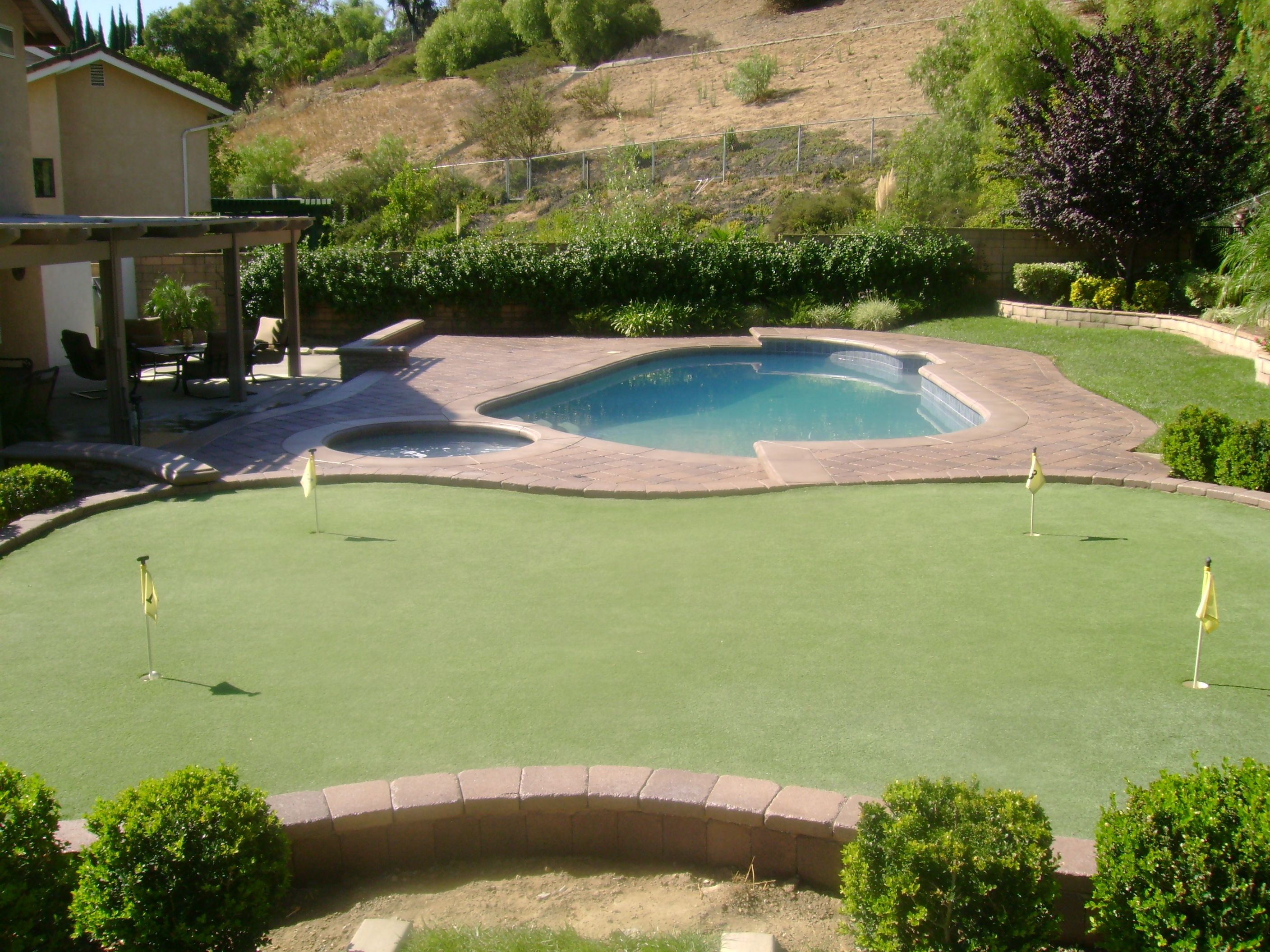 Putting Green Off The Pool Deck Outdoor Spaces