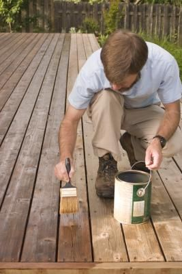 How To Remove Deck Stain From Vinyl Siding Hunker Staining Deck Deck Maintenance Deck Stain Colors