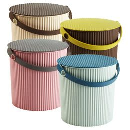 """Omni Bucket Mocha  10-1/2"""" diam. x 10-1/2"""" h  10060035 .The outstanding Japanese design and quality of our Omni Bucket is simply irresistible. With it's ribbed texture, soft colors and generous storage capacity, it's ideal for a nursery or playroom. And you won't believe how strong it is. Put the lid on, and doubles as a stool that can hold up to 330 pounds! A handle makes it easy for little ones to carry items from room to room. It's also great for holding gardening or craft supplies. $22"""