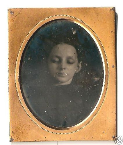 A post mortem daguerreotype of a young girl.