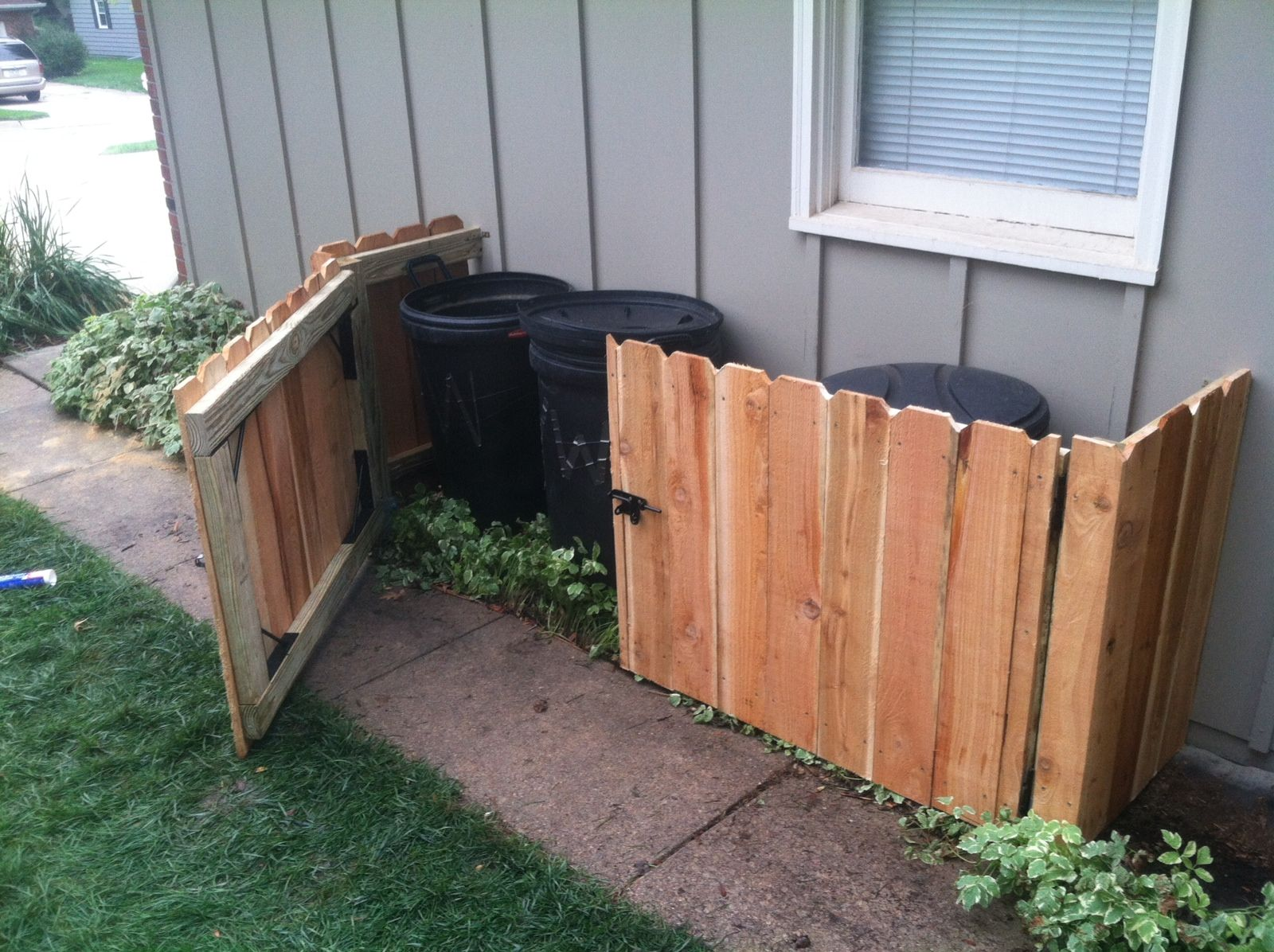 DIY trash can storage Front yard landscape