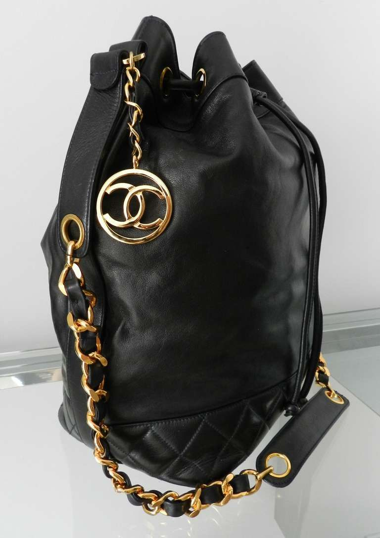 View this item and discover similar handbags and purses for sale at 1stdibs  - Vintage Chanel black leather drawstring bucket bag. This bag was never  used ... 8c06c377e6cb5
