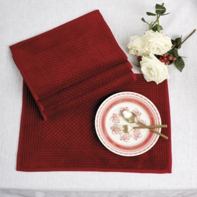 We designed these Velvet Quilted Placemats with two personalities, so you can use them for any occasion. On one side, they're richly quilted red velvet - perfect for an elegant holiday supper. On the reverse, they're red cotton just right for everyday.