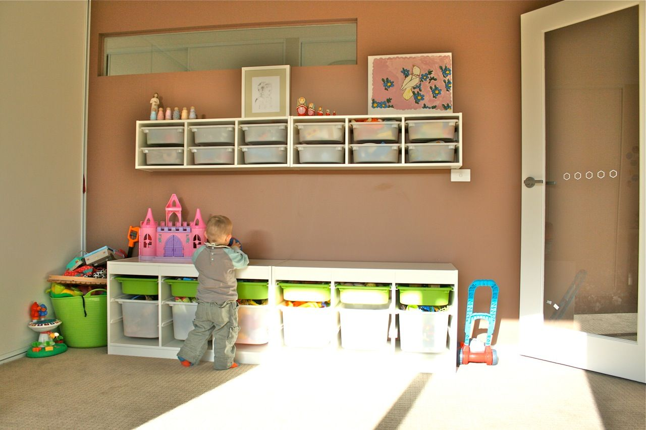 Storage Shelves Hanging Up Higher In Toy Room Home