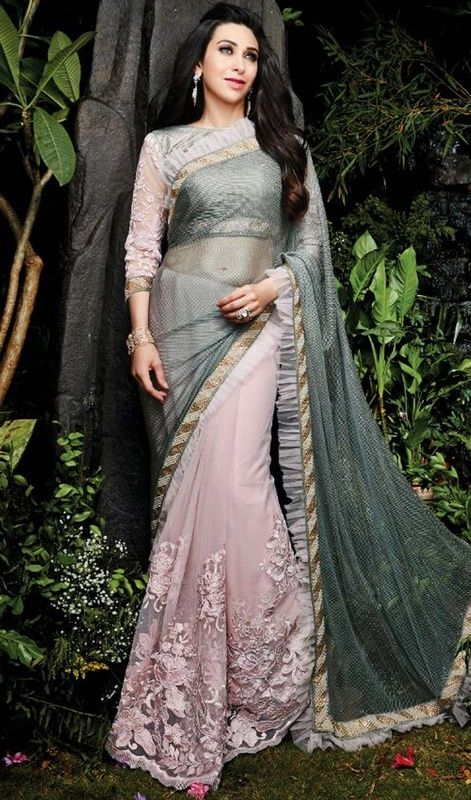 Let the angels stare at you in awe like Karisma Kapoor as you glide in this gray and pink color embroidered net half n half sari. The ethnic lace, sequins and resham work in the attire adds a sign of attractiveness statement for your look. #nethalfnhalfsari #bollywoodsaris #womendesignersaree