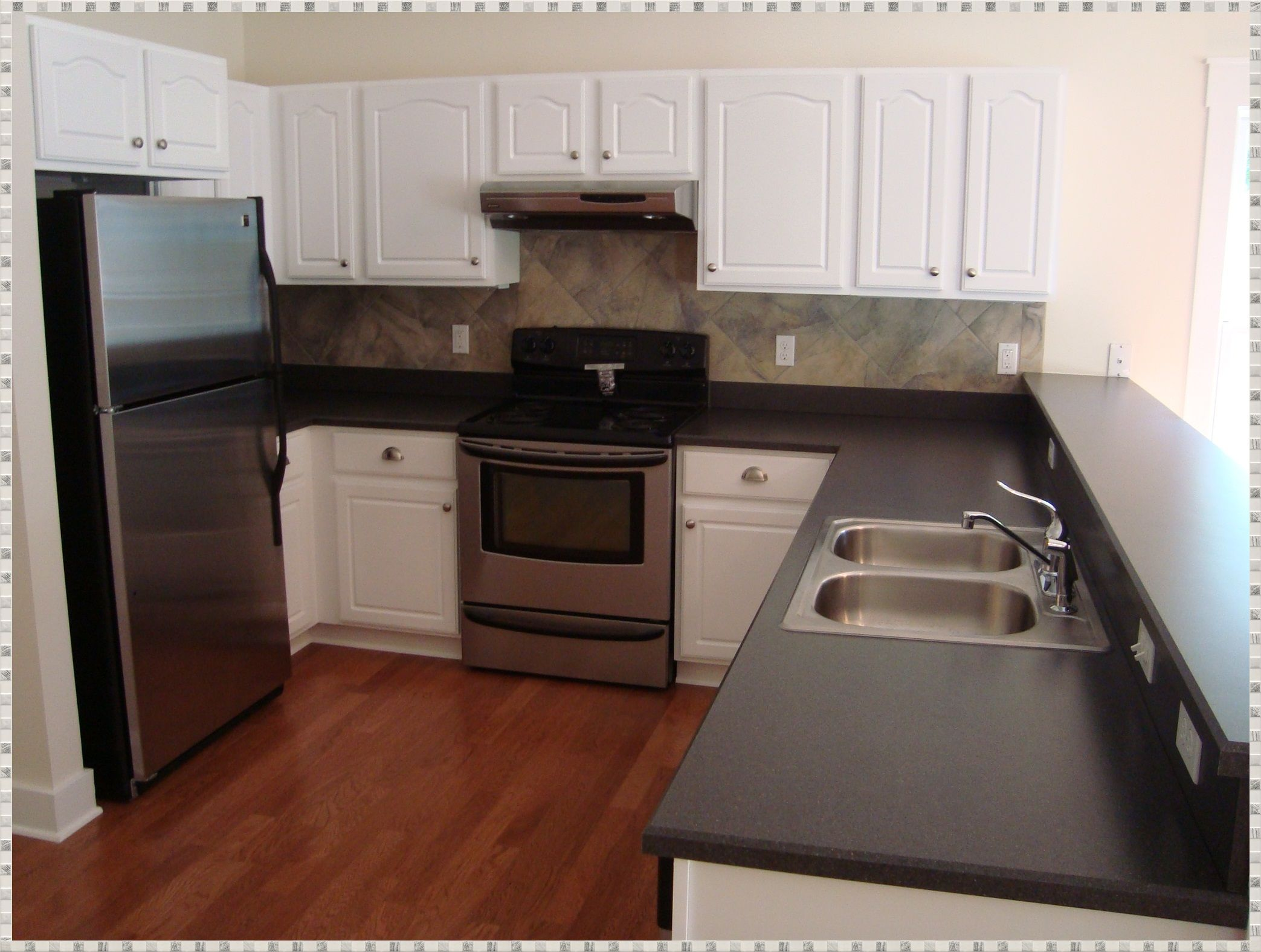 Off White Kitchen Cabinets With Black Stainless Appliances