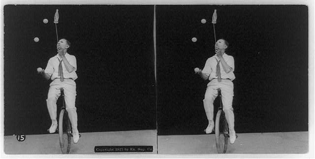 Unknown performer on a unicycle juggling three balls and balancing a soda bottle on a stick. (Stereograph)