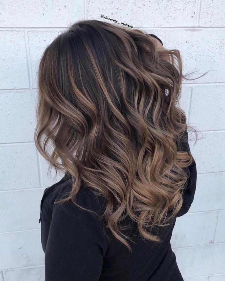 från svart till brunt hår