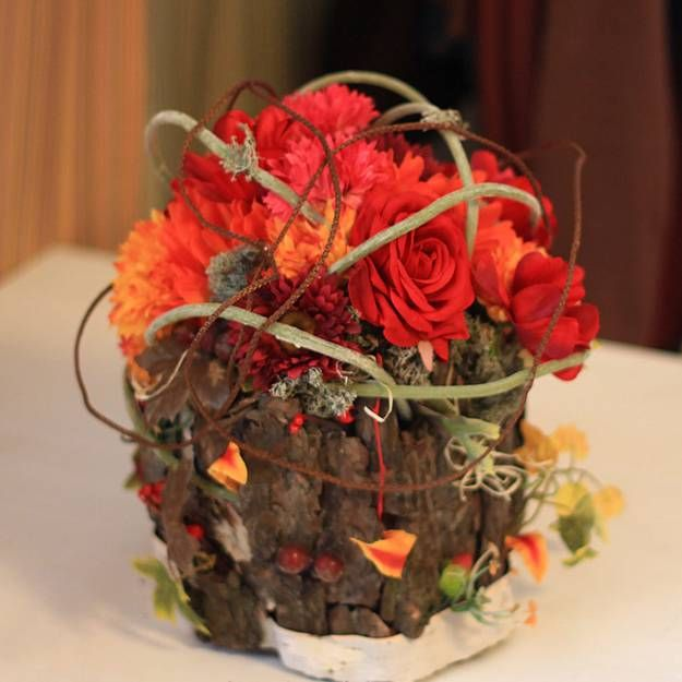 Colorful fall flower arrangements and autumn table