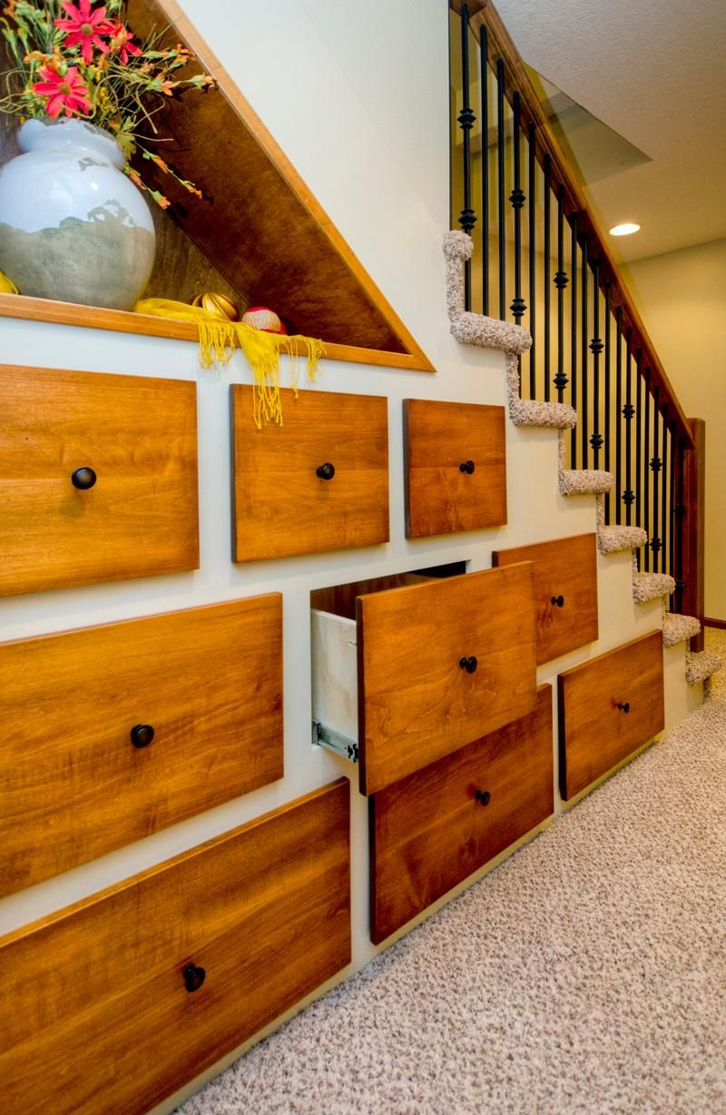 12 Creative Ways To Use The Space Under Your Stairs Staircase Design Home Remodeling Understairs Storage