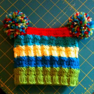 Knitted love!  My favorite baby hat pattern by Susan B Anderson.