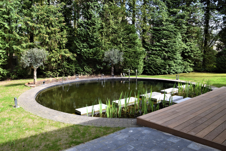Ronde zwemvijver ombouw zwembad zwemvijver zwemvijver for Aanleg zwemvijver