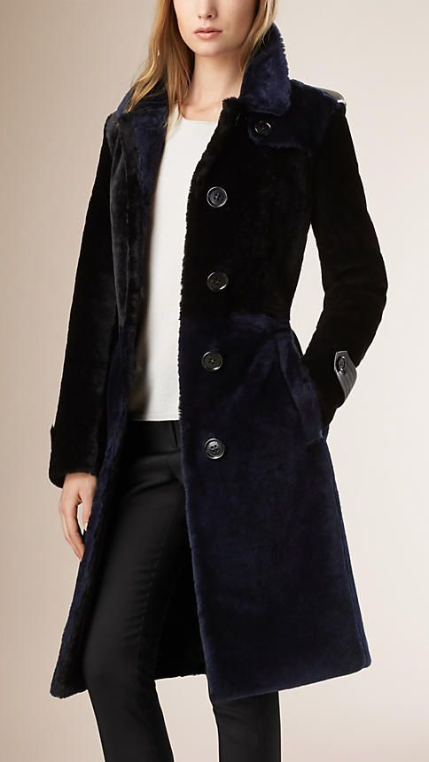 Burberry Colour Block Shaved Shearling Trench Coat - A trench coat crafted from panels of tonal shaved shearling. The gently tailored design is tapered at the waist with a leather belt closure. Discover the women's outerwear collection at Burberry.com