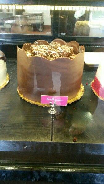 Earth quake , with chocolate wall build around cake !