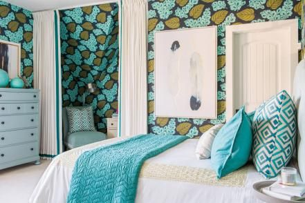 Attention-grabbing wallpaper with teal, navy and green flowers adds fun and personality to this chic guest bedroom.