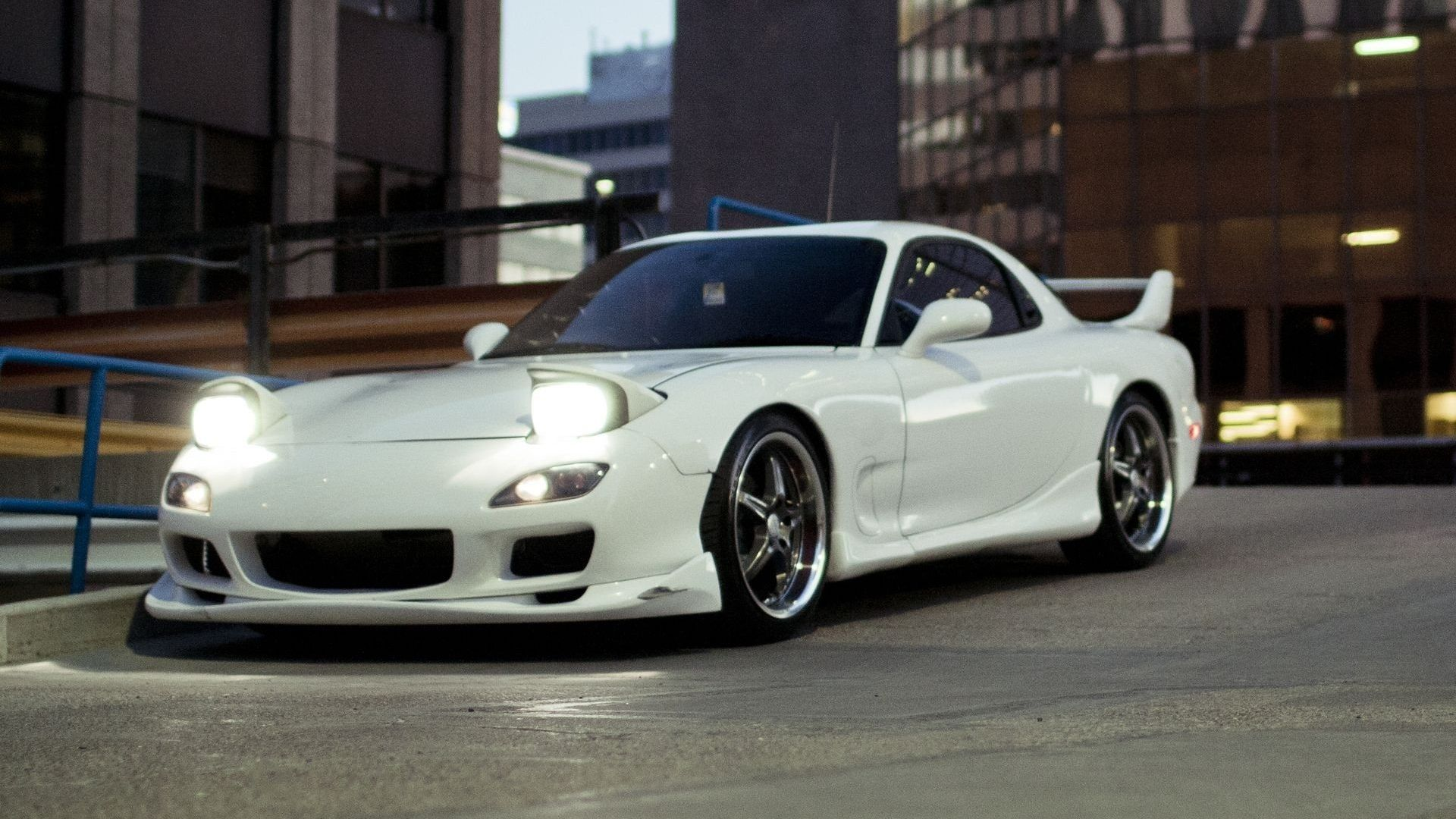 The Mazda RX-7 is a sports car produced by the Japanese automaker Mazda from 1978 to 2002. Description from sport.pgzmedia.com. I searched for this on bing.com/images